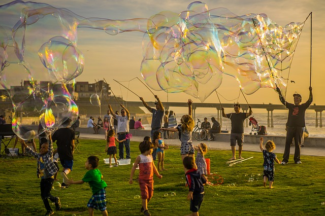 Crowd generating enormous soap bubbles