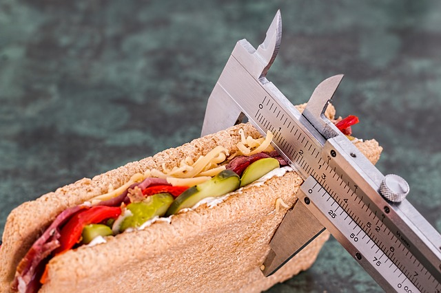 Calipers measuring thickness of a sandwich