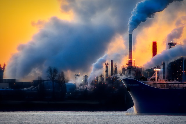 Industrial skyline with smoke pollution