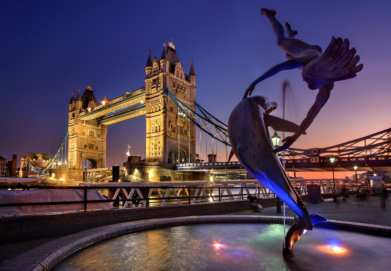 Statue of woman diver and dolphin dancing together
