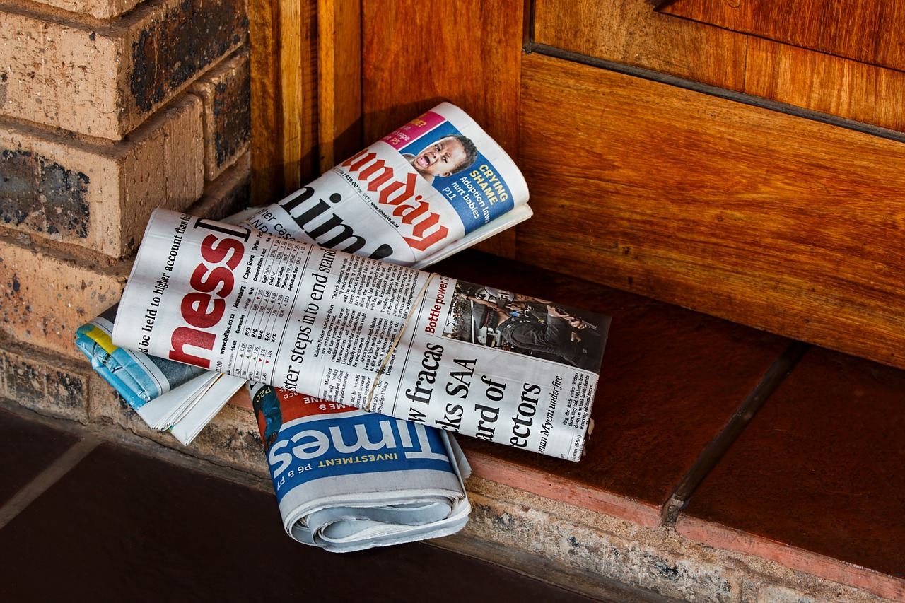 Folded newspapers on doorstep