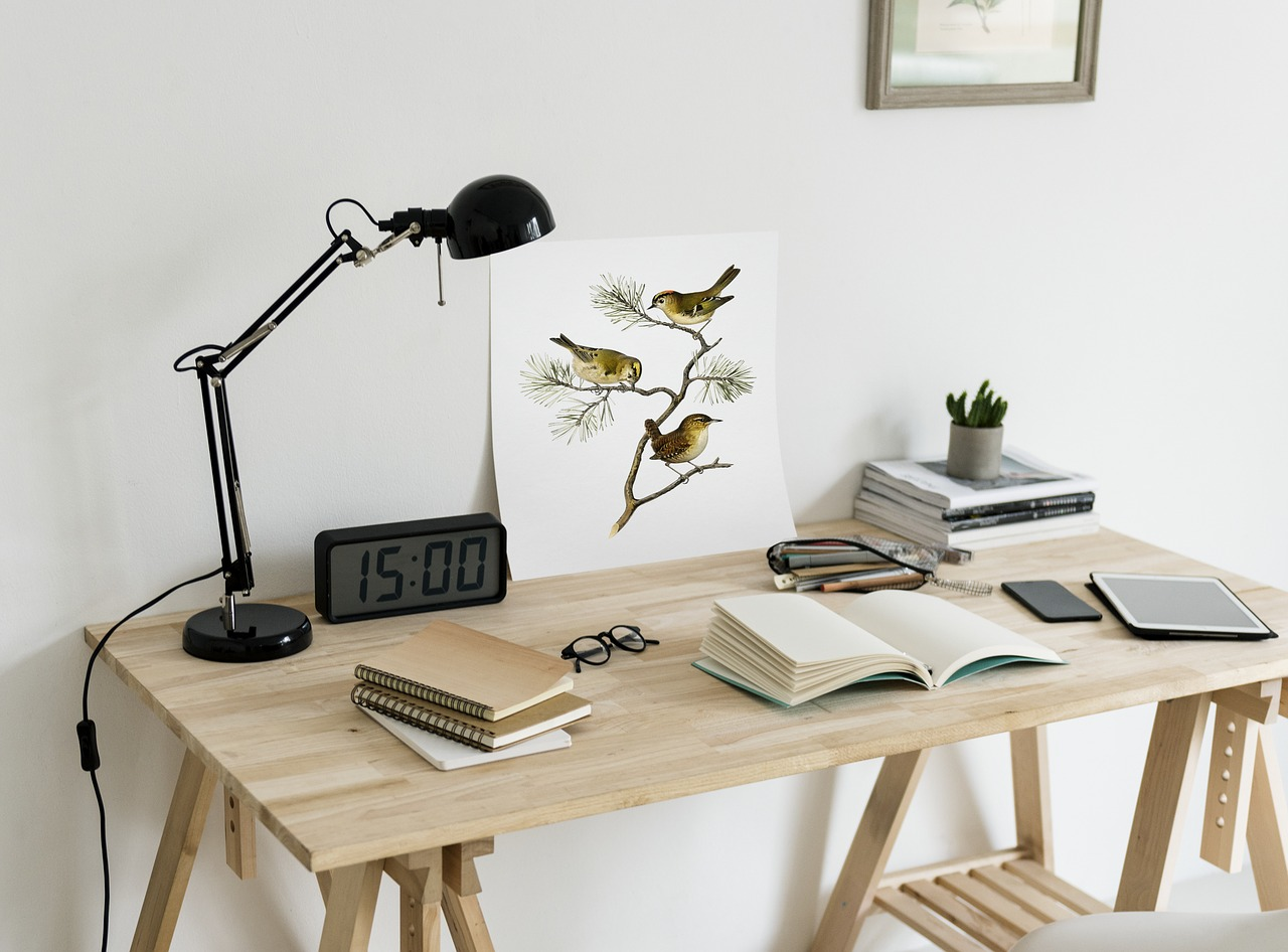 Desk with books, painting, lamp, radio ...