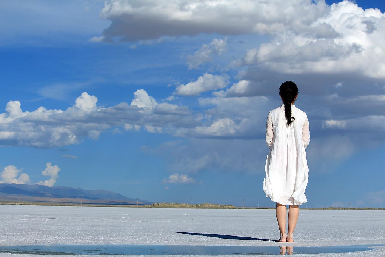 woman facing huge horizon